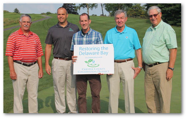 The Chester County Conservation District recognized the Kennett Square Golf and Country Club as Watershed Partners in the Delaware Bay. Pictured left to right: Pete Torras, Green Chairman Kennett Square Golf and Country Club, Christian E. Strohmaier, Managing Director, CCCD; Paul Stead, Superintendent, Kennett Square Golf and Country Club; Wayne Moore, President, Kennett Square Golf and Country Club, and Bill Fenstermacher, Kennett Square Golf and Country Club Green Committee Member. Photo provided by Chester County Conservation District.