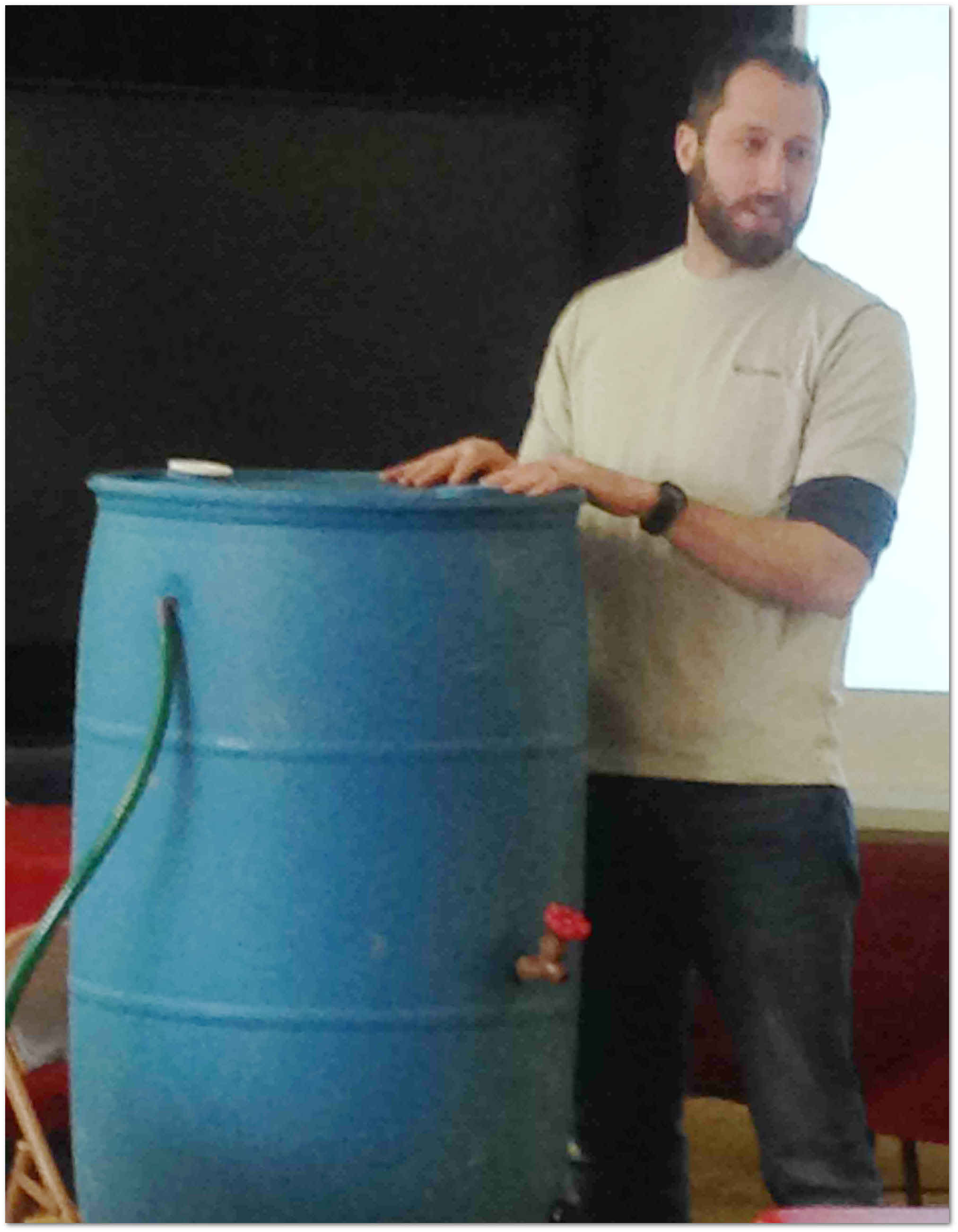 Trevor Weaver, Mifflin County Conservation District's Outreach and Technical Assistant demonstrates how to build a rain barrel during the workshop held in Burnham on March 19, 2016. Another workshop was held in the Upper Kishacoquillas Creek Watershed in Belleville on March 22. Photo provided by Mifflin County Conservation District.