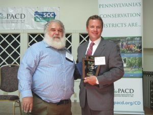 PACD President Glenn Seidel presents the Legislator Leadership Award to Representative Tommy Sankey during the PACD/SCC Awards Luncheon on July 27, 2016 in State College. Representative Sankey was nominated by the Clearfield County Conservation District.