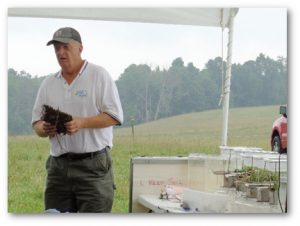 Tim Elder, USDA Natural Resources Conservation Service Northwest Pennsylvania Grazing Specialist, performs a soil health demonstration during the field day. Photo provided by the Jefferson County Conservation District.