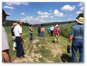 Tour participants learn about the native plants grown at the Friendship Farms nursery.  Photo provided by Westmoreland Conservation District.